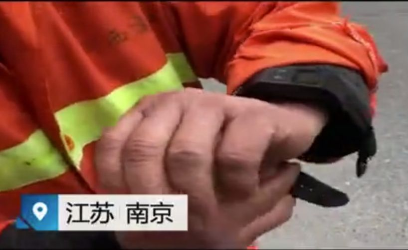These Chinese sanitation workers have to wear location-tracking bracelets now