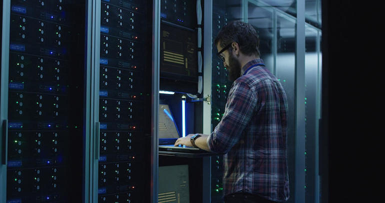 Bearded computer specialists configuring servers in the data center