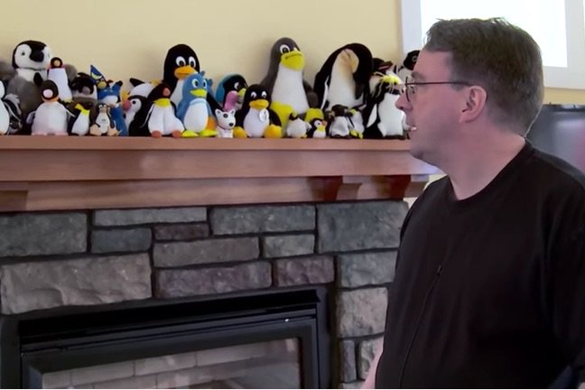 Linus Torvalds with toy penguins